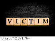 Купить «Word VICTIM isolated on black background», фото № 12371764, снято 20 сентября 2019 г. (c) PantherMedia / Фотобанк Лори