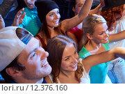 Купить «smiling friends at concert in club», фото № 12376160, снято 20 октября 2014 г. (c) Syda Productions / Фотобанк Лори