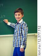 Купить «little smiling schoolboy writing on chalk board», фото № 12377112, снято 15 ноября 2014 г. (c) Syda Productions / Фотобанк Лори