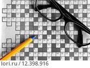 Купить «top view of blank crossword puzzle with black eyeglasses and a pen», фото № 12398916, снято 19 февраля 2018 г. (c) PantherMedia / Фотобанк Лори