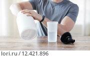 Купить «close up of man with protein shake bottle and jar», видеоролик № 12421896, снято 16 мая 2015 г. (c) Syda Productions / Фотобанк Лори
