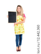 Купить «Beautiful woman with apron and menu bord», фото № 12442360, снято 19 января 2019 г. (c) PantherMedia / Фотобанк Лори