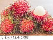 Купить «Fresh rambutans on wodden tray», фото № 12446088, снято 18 июня 2019 г. (c) PantherMedia / Фотобанк Лори