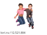 Купить «Children's couple jumping isolated in white», фото № 12521884, снято 19 февраля 2019 г. (c) PantherMedia / Фотобанк Лори