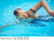Купить «Young girl in goggles and cap swimming crawl stroke style in the blue water pool», фото № 12530072, снято 26 марта 2019 г. (c) PantherMedia / Фотобанк Лори