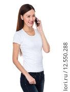 Купить «Asian woman talk to cellphone», фото № 12550288, снято 17 января 2020 г. (c) PantherMedia / Фотобанк Лори