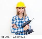 Купить «Woman doing the DIY work and wearing protective helmet», фото № 12550672, снято 17 июня 2019 г. (c) PantherMedia / Фотобанк Лори