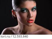 Купить «Портрет красивой девушки с ярким макияжем», фото № 12593840, снято 27 июля 2015 г. (c) Andriy Bezuglov / Фотобанк Лори