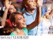 Купить «smiling friends at concert in club», фото № 12638620, снято 20 октября 2014 г. (c) Syda Productions / Фотобанк Лори