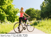 happy young woman riding bicycle outdoors. Стоковое фото, фотограф Syda Productions / Фотобанк Лори