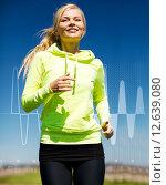 smiling woman jogging outdoors. Стоковое фото, фотограф Syda Productions / Фотобанк Лори