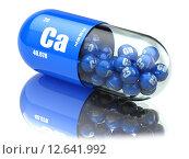 Pills with calcio CA element Dietary supplements. Vitamin capsules. Стоковое фото, фотограф Maksym Yemelyanov / Фотобанк Лори