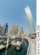 Купить «Dubai - AUGUST 9, 2014: Dubai Marina district on August 9 in UAE. Dubai is fastly developing city in Middle East», фото № 12648336, снято 9 августа 2014 г. (c) Elnur / Фотобанк Лори