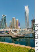 Купить «Dubai - AUGUST 9, 2014: Dubai Marina district on August 9 in UAE. Dubai is fastly developing city in Middle East», фото № 12648436, снято 9 августа 2014 г. (c) Elnur / Фотобанк Лори