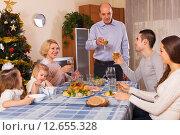 Купить «United family at festive table», фото № 12655328, снято 13 ноября 2019 г. (c) Яков Филимонов / Фотобанк Лори