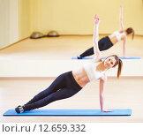 Купить «pilates stretching fitness exercises», фото № 12659332, снято 28 февраля 2015 г. (c) Дмитрий Калиновский / Фотобанк Лори