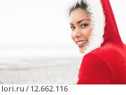 Attractive woman wearing a christmas styled jumper. Стоковое фото, агентство Wavebreak Media / Фотобанк Лори