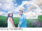 Купить «Composite image of happy hipster couple holding hands and smiling at camera», фото № 12666852, снято 26 мая 2020 г. (c) Wavebreak Media / Фотобанк Лори