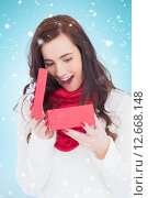 Купить «Composite image of surprised brunette opening christmas gift», фото № 12668148, снято 21 сентября 2018 г. (c) Wavebreak Media / Фотобанк Лори