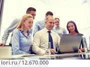 Купить «smiling business people with laptop in office», фото № 12670000, снято 25 октября 2014 г. (c) Syda Productions / Фотобанк Лори