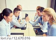 Купить «smiling business people having conflict in office», фото № 12670016, снято 25 октября 2014 г. (c) Syda Productions / Фотобанк Лори