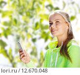 Купить «happy woman with smartphone and earphones», фото № 12670048, снято 19 июня 2013 г. (c) Syda Productions / Фотобанк Лори