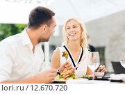 Купить «happy couple eating dinner at restaurant terrace», фото № 12670720, снято 15 июля 2015 г. (c) Syda Productions / Фотобанк Лори
