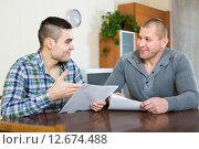 Купить «Flatmates discussing tenancy», фото № 12674488, снято 22 июля 2019 г. (c) Яков Филимонов / Фотобанк Лори