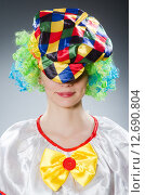 Купить «Clown in the funny concept», фото № 12690804, снято 12 июня 2015 г. (c) Elnur / Фотобанк Лори