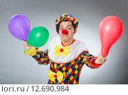 Купить «Clown with balloons in funny concept», фото № 12690984, снято 2 июля 2015 г. (c) Elnur / Фотобанк Лори