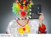 Купить «Clown with movie clapper in funny concept», фото № 12726304, снято 12 июня 2015 г. (c) Elnur / Фотобанк Лори
