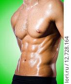 Купить «Muscular man isolated on the white», фото № 12728164, снято 11 октября 2012 г. (c) Elnur / Фотобанк Лори