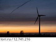 Купить «Hinte, Germany, Wind Turbine in the dusk», фото № 12741216, снято 9 ноября 2014 г. (c) Caro Photoagency / Фотобанк Лори