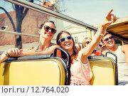 Купить «group of smiling friends traveling by tour bus», фото № 12764020, снято 20 июля 2014 г. (c) Syda Productions / Фотобанк Лори