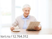 Купить «senior woman with coffee reading newspaper at home», фото № 12764312, снято 10 июля 2015 г. (c) Syda Productions / Фотобанк Лори