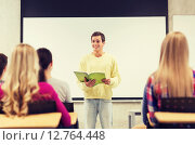 Купить «group of smiling students in classroom», фото № 12764448, снято 7 сентября 2014 г. (c) Syda Productions / Фотобанк Лори
