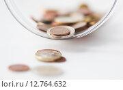 Купить «close up of euro coins in glass jar on table», фото № 12764632, снято 30 июля 2015 г. (c) Syda Productions / Фотобанк Лори