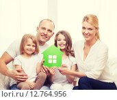 Купить «smiling parents and two little girls at new home», фото № 12764956, снято 1 марта 2014 г. (c) Syda Productions / Фотобанк Лори