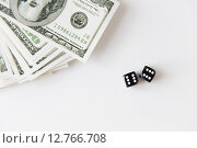 Купить «close up of black dice and dollar money on table», фото № 12766708, снято 30 июля 2015 г. (c) Syda Productions / Фотобанк Лори