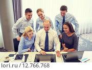 Купить «smiling business people with laptop in office», фото № 12766768, снято 25 октября 2014 г. (c) Syda Productions / Фотобанк Лори