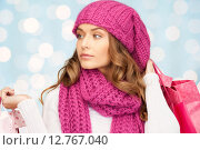 Купить «young woman in winter clothes with shopping bags», фото № 12767040, снято 10 октября 2010 г. (c) Syda Productions / Фотобанк Лори