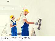 Купить «group of builders with tools indoors», фото № 12767216, снято 25 сентября 2014 г. (c) Syda Productions / Фотобанк Лори