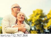 Купить «senior couple hugging in park», фото № 12767364, снято 4 сентября 2014 г. (c) Syda Productions / Фотобанк Лори