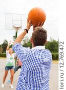 Купить «group of happy teenagers playing basketball», фото № 12769472, снято 10 августа 2014 г. (c) Syda Productions / Фотобанк Лори