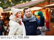 Купить «couple taking selfie with smartphone in old town», фото № 12769496, снято 11 декабря 2014 г. (c) Syda Productions / Фотобанк Лори