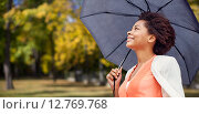 Купить «happy african woman with umbrella in autumn park», фото № 12769768, снято 8 июля 2015 г. (c) Syda Productions / Фотобанк Лори