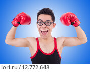 Купить «Funny boxer isolated on the white background», фото № 12772648, снято 15 апреля 2013 г. (c) Elnur / Фотобанк Лори