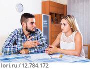 Купить «Couple discussing serious financial situation», фото № 12784172, снято 27 мая 2018 г. (c) Яков Филимонов / Фотобанк Лори