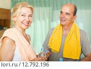 Купить «Elderly couple after training», фото № 12792196, снято 16 июля 2014 г. (c) Яков Филимонов / Фотобанк Лори
