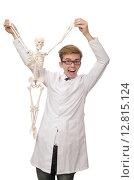 Купить «Funny doctor with skeleton isolated on white», фото № 12815124, снято 18 ноября 2014 г. (c) Elnur / Фотобанк Лори